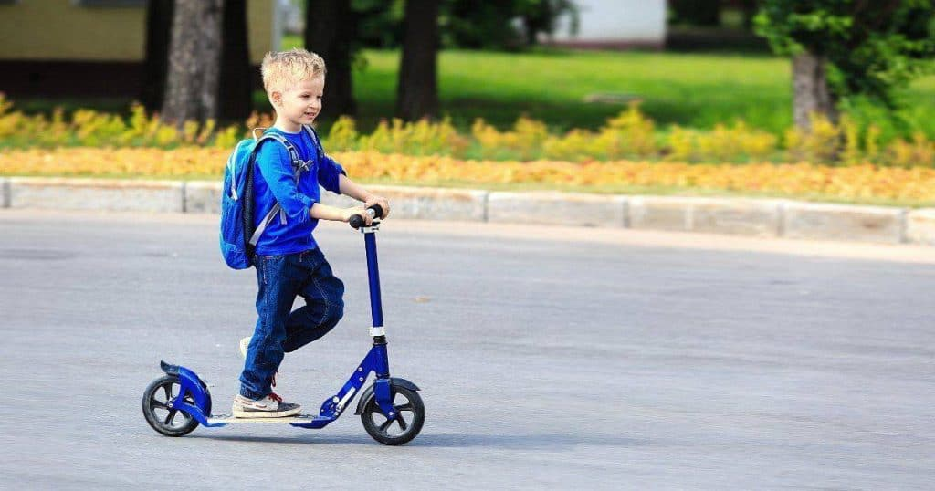 an image of a boy with the best 2 wheel scooter