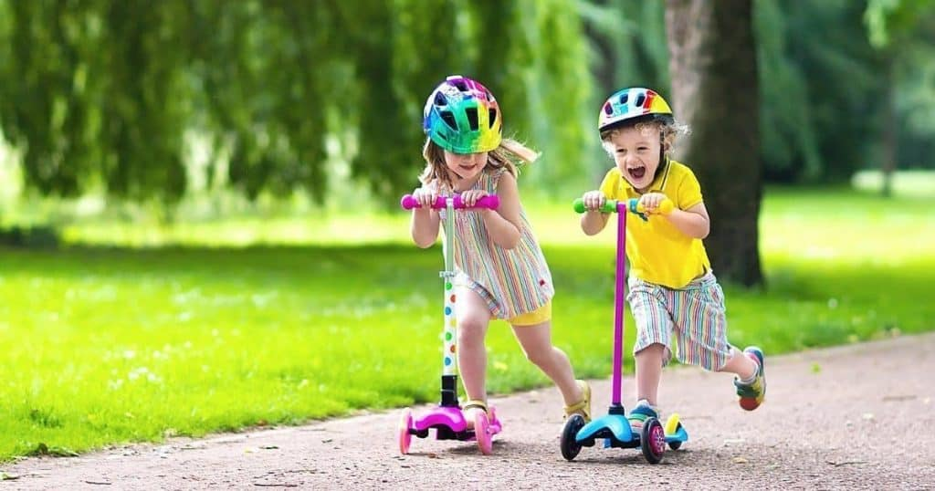 an image of a boy and a girl enjoying the best kids scooter