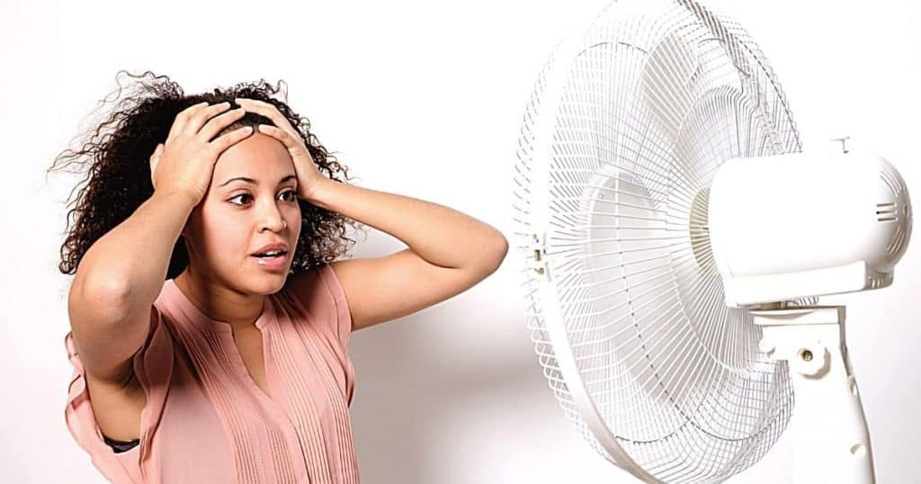 an image of woman thinking what's the best air cooler