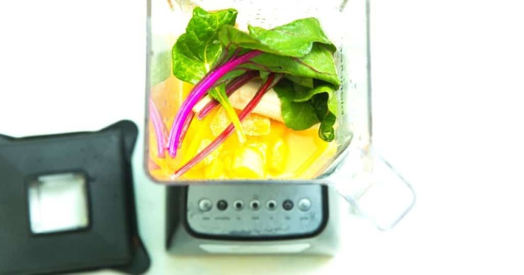 an image showing the best cheap blender with some vegetables ready to make soup