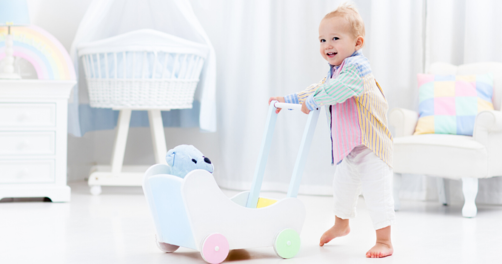 an image of a toddler boy using the best baby walker