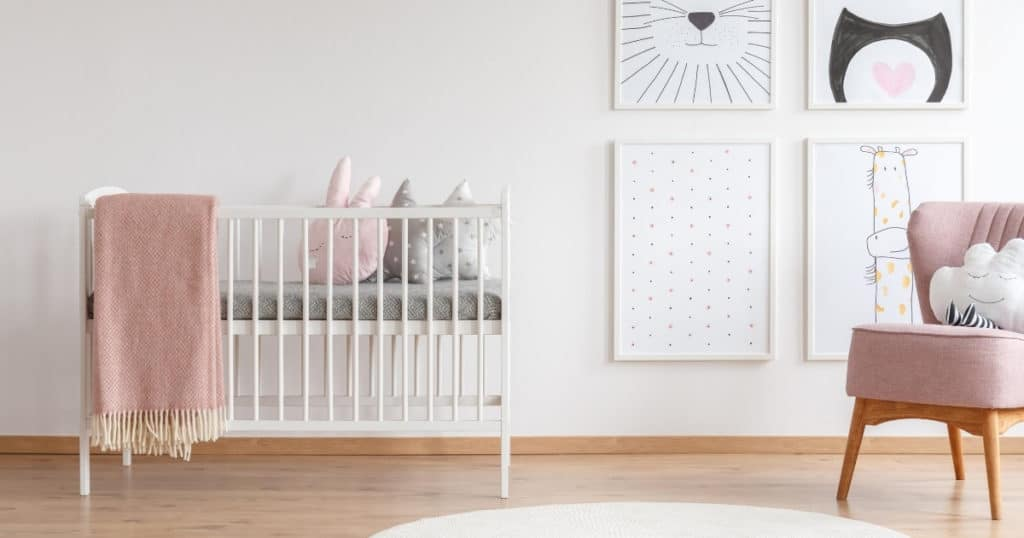 an image of the best cot in a cute baby girl nursery