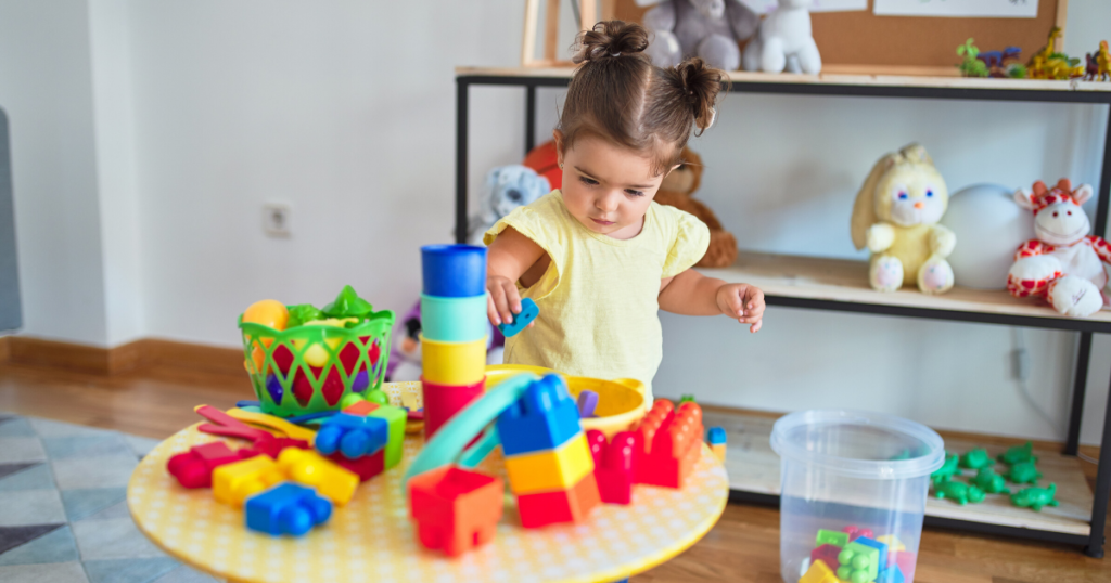 an image of a little girl playing one of the best toys for 3 year olds