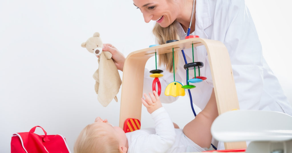 an image of a doctor and baby playing the best baby activity centre