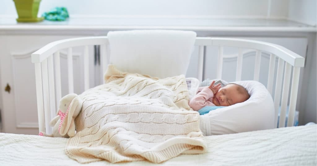 an image of a sleeping baby in the best bassinet